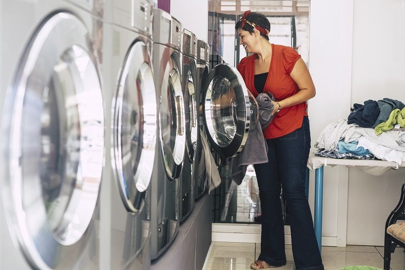 nice-young-brunette-wash-and-clean-some-dresses-and-clothes-at-the-laundry-mat-service-cm